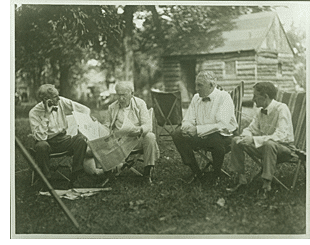 Friends Henry Ford, Thomas Edison and Harvey Firestone pictured with President Warren G. Harding on a camping trip that the four took together in Maryland with members of their families, July 23-24, 1921.